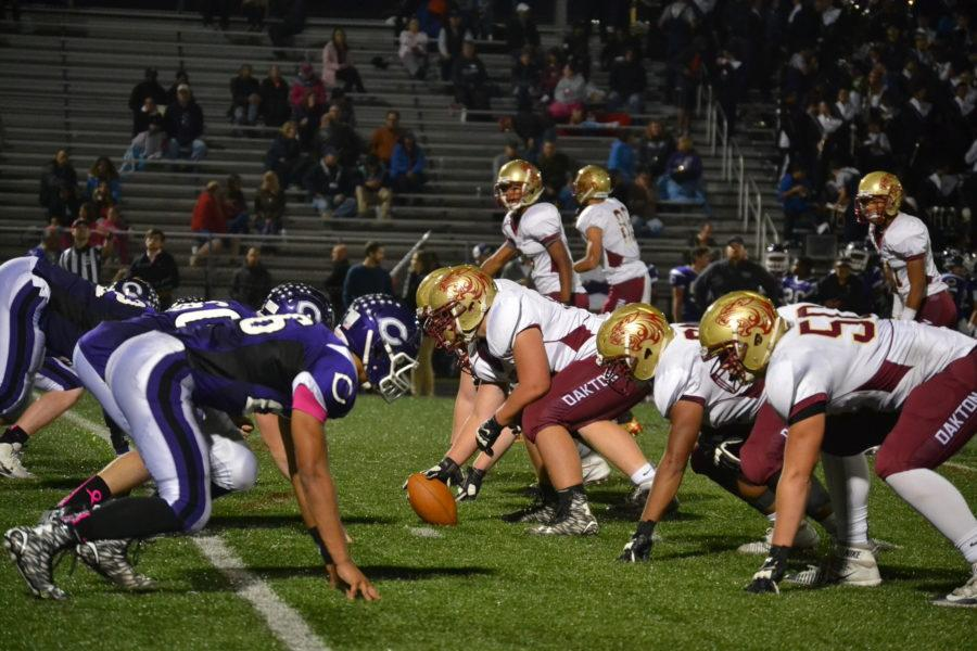 Players set in position before the snap at the game.
