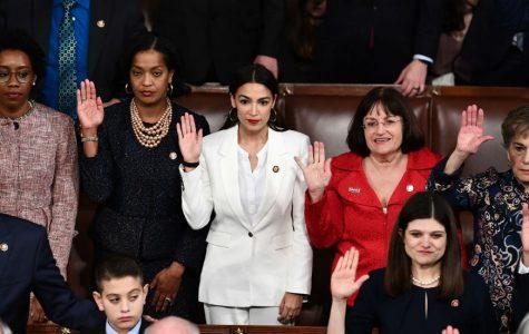 Alexandria Ocasio-Cortez, along with her fellow representatives, being sworn into Congress