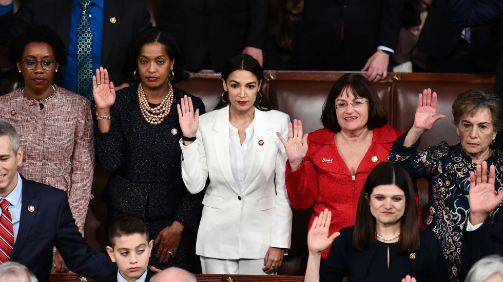 Alexandria Ocasio-Cortez, along with her fellow representatives, being sworn into Congress