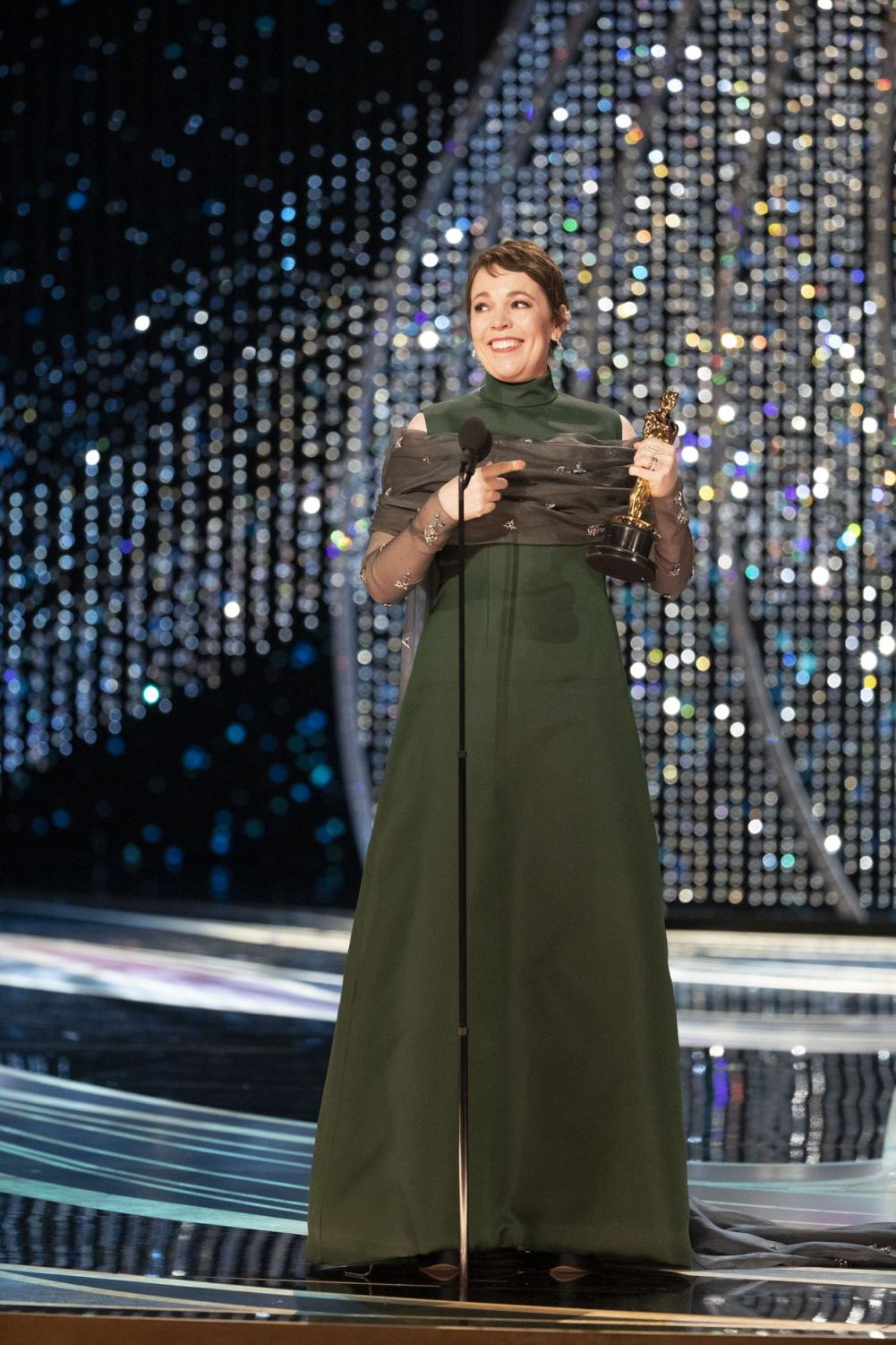 This is a picture of best actress winner Olivia Colman accepting her Oscar. Picture credits to Getty Images.